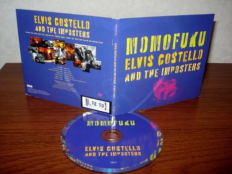 33 Elvis Costello & The Imposters - Momofuku